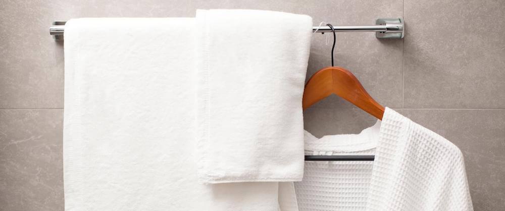 bath towel and hand towel on rack