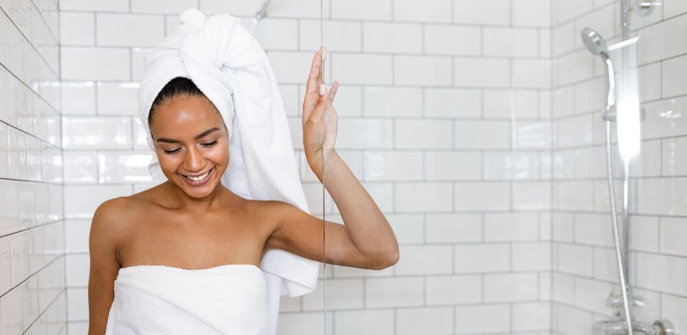 woman wearing bath towel in shower