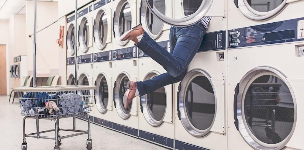 Person diving inside washer