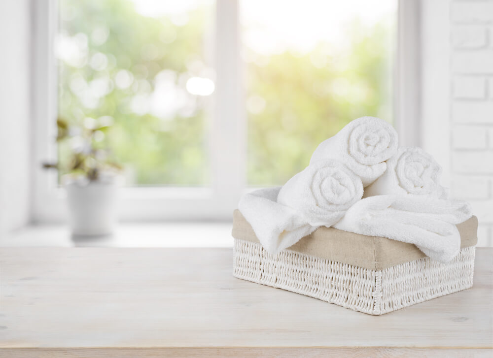 Bath towels in basket on counter